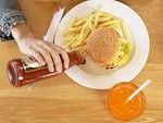 pouring ketchup on plate